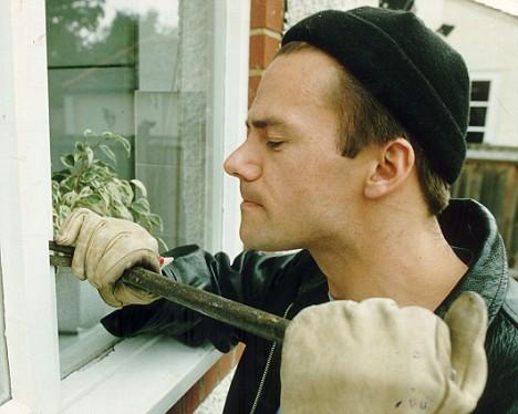 burglar with pry bar