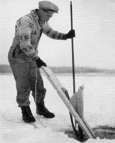Putting Jigger under the ice. Photo from Web attempting to trace source. Man is wearing an